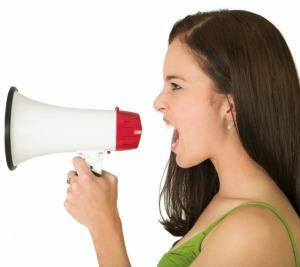 Girl shouting on the megaphone
