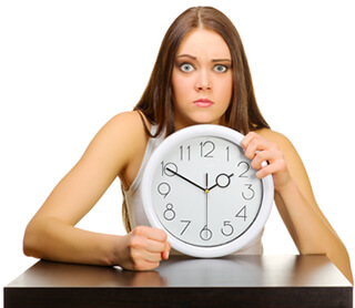 angry girl showing a clock
